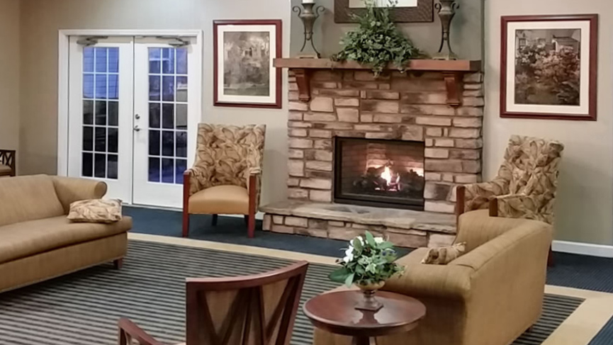 Gaines Park Senior Living | Community area with fireplace