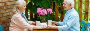 Gaines Park Senior Living | Senior couple drinking tea outdoors