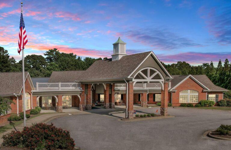 Gaines Park Senior Living   Exterior entrance at sunset
